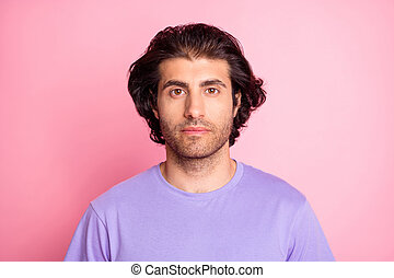 Photo of young attractive serious multiethnic guy wear casual outfit isolated over pink color background