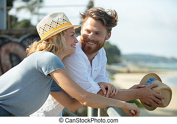 photo of young couple man and woman smiling