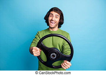 Photo of young driver person impressed open mouth toothy smile green sweater isolated on blue color background