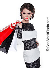 Photo of young elegant woman with shopping bags  isolated on white