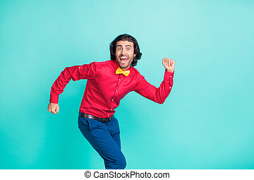 Photo of young handsome funky funny gentleman dancing grimacing wear bow tie isolated on turquoise color background