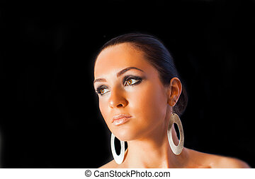 Photo of young woman face with stylish makeup