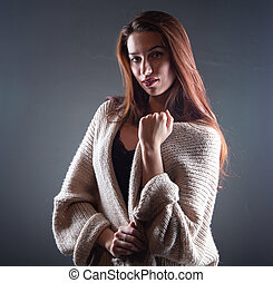 Photo of young woman with long hair in shadows
