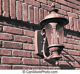 old vintage lamp on brick wall