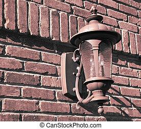 old vintage lamp on brick wall