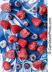 Photo on top of frozen blueberries and raspberries