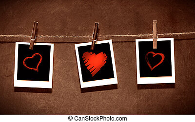 Photo paper attach to rope with clothes spins on grunge background/ Valentine theme