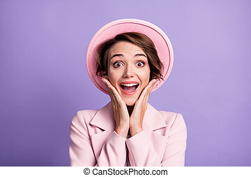 Photo portrait of cute charming lady dressed retro pink headwear open mouth arms cheekbones isolated violet color background