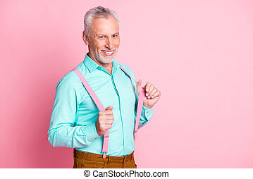 Photo portrait of grandfather preparing for party wearing teal shirt suspenders smiling isolated on pink color background