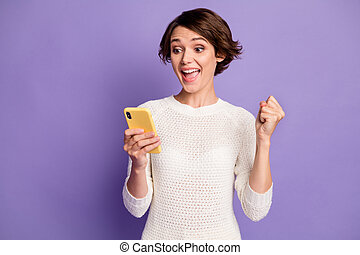 Photo portrait of happy yelling brunette girl gesturing like winner reading post isolated on bright violet color background