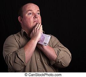 portrait of male praying on black background