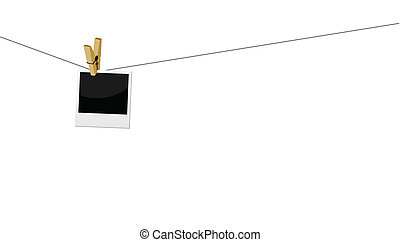 photo prints hanging on string - photo frame attached on a...