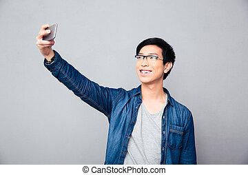 photo, selfie, jeune, asiatique, confection, homme souriant
