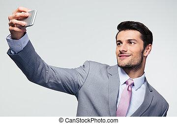 photo, selfie, smartphone, homme affaires, confection
