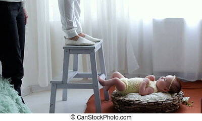 photo shoot of a newborn baby in a basket in the studio...