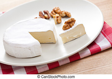 brie cheese - photo shot of brie cheese