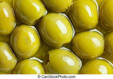 photo shot of green olives in olive oil