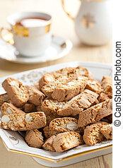 photo shot of italian cantuccini cookies with tea