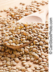lentil on wooden spoon - photo shot of lentil on wooden...