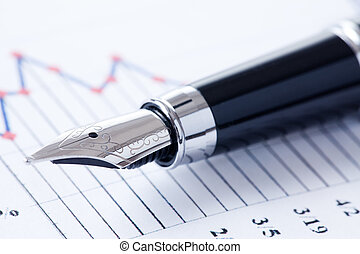 pen and business graph - photo shot of pen and business...