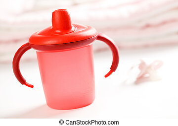 red baby bottle