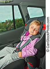 sleeping child in car seat
