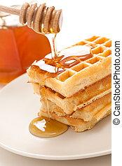 waffle with honey - photo shot of waffle with honey
