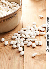 white beans on wooden table - photo shot of white beans on ...