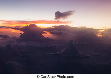 Spectacular view sunrise above clouds from airplane window. Soft focus