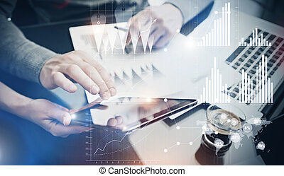 Photo teamwork process. Risk department managers working new global project in office. Using electronic devices. Graphics icons, worldwide stock exchanges interface. Horizontal