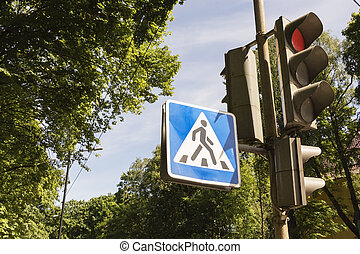 photo traffic light and sign of a pedestrian crossing in the city.