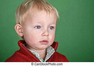young male child portrait on green screen