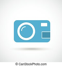 Photocamera with shadow on the gray background.