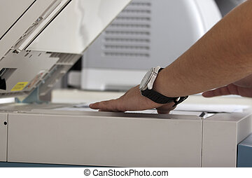Photocopy - Business man with his finger on the start key...