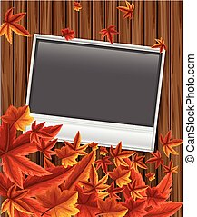 Photoframe on wooden board with leaves