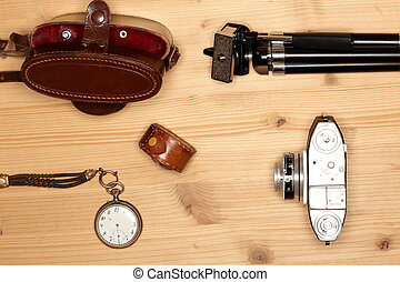 Photograph equipment on wooden table
