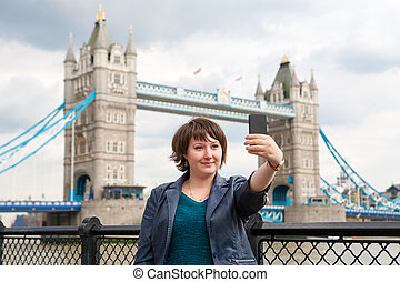 Photograph of herself. London, UK - Young woman taking a...
