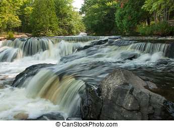 Bond Falls - Photograph of one of the smaller upper falls at...