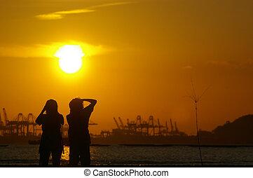 photographe, à, coucher soleil