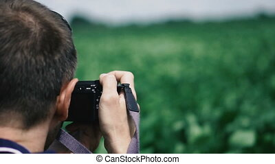 Photographer. A photographer with a camera shoots a...