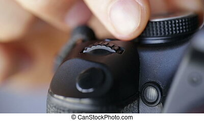 Photographer adjusts the camera and take pictures. Close up