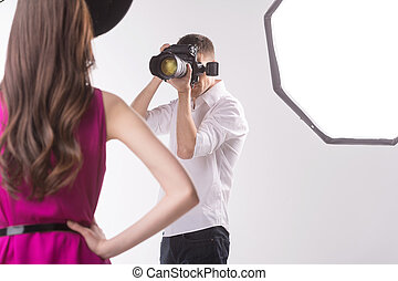 Photographer and model. Young man photographing fashion ...