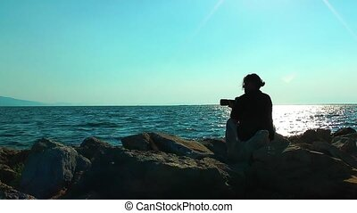 Photographer and the Sea