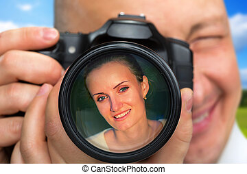 Photographer capturing portrait of beautiful woman