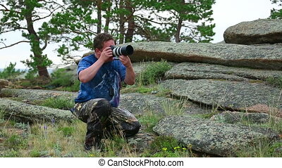 Photographer take a shoot in front of the camera