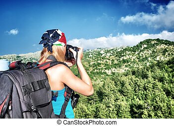 Photographer girl in the mountains