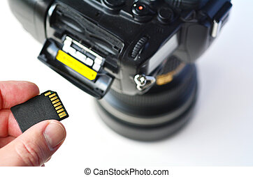 Memory card - Flash card - Photographer hand holds Memory...