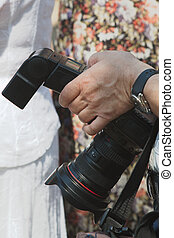 Photographer holding a the camera