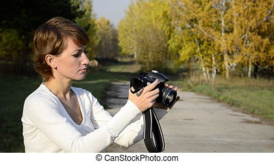 photographer in autumn park