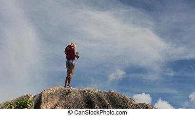 photographer in Source d'Argent beach - top of Anse Source...